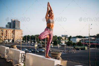 Woman meditating in yoga pose, balance exercise
