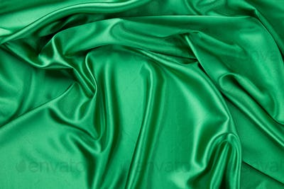 Green silk cloth with soft folds.