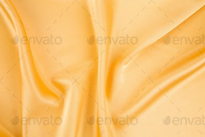 Close up of yellow silk cloth texture.