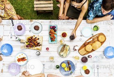 Aerial view of diverse friends gathering having food together
