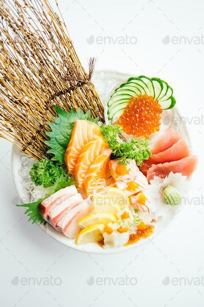 Raw and fresh mixed sashimi with salmon , tuna , hamaji and othe