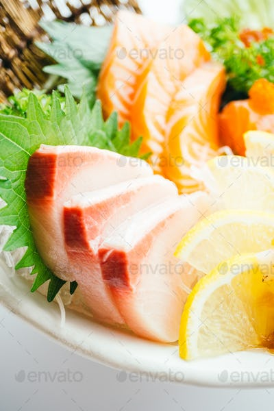 Raw and fresh mixed sashimi with salmon , tuna , hamaji and othe