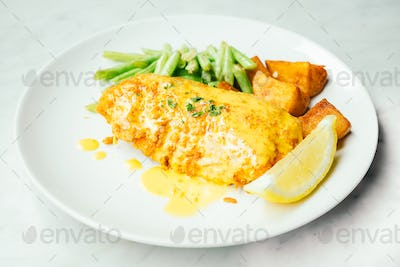 Fried chicken steak with lemon and vegetable