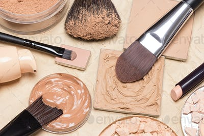 Foundation makeup products on crumpled paper