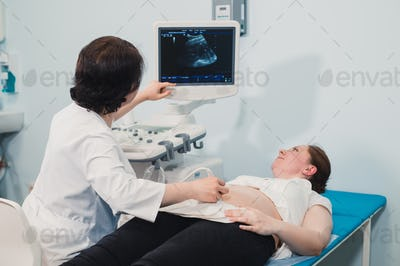 Pregnant woman receiving ultrasound treatment in hospital
