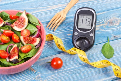 Fruit and vegetable salad and glucometer with tape measure