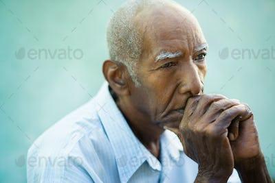 Portrait Of Sad Bald Senior Man