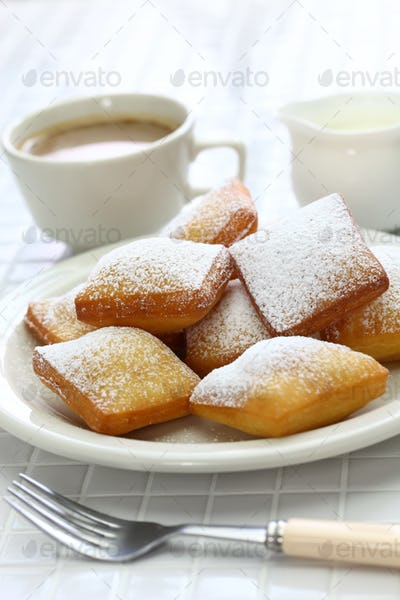 homemade new orleans beignet and a cup of coffee