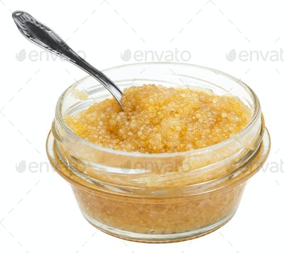 open glass jar with caviar of pike fish with spoon