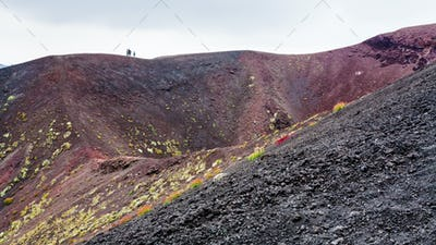people on edge of crater on Mount Etna