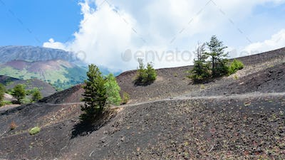 path between old craters of the Etna mount
