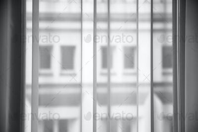 transparent curtain from tulle fabric on window