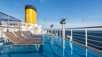 upper deck of cruise liner with empty chairs