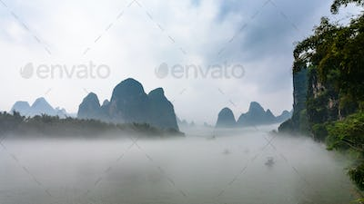 panoramic view of fog over river near Xingping