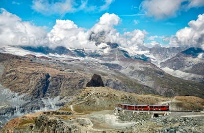 Landscape of snowy mountains with railway, swiss Alps
