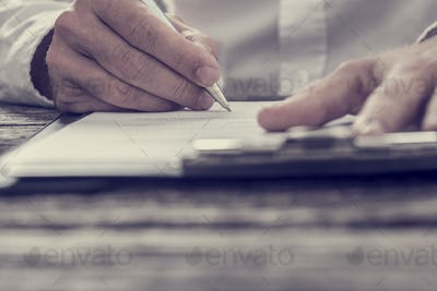 Toned image of male hand signing business contract