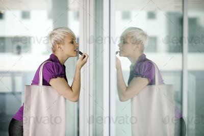 Young Business Woman Applying Makeup In The Street