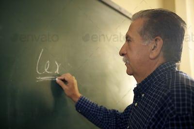 People And Education Law Teacher Writing On Blackboard