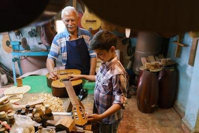 Lute Maker Grandpa Teaching Boy Grandson Tuning Guitar