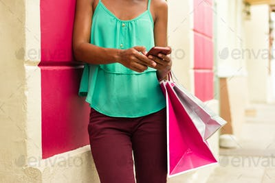 African Girl Sending Text Messaging On Phone Shopping