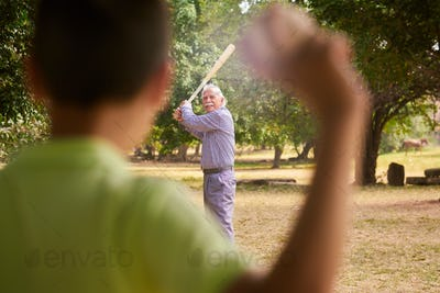 Grandpa and Grandson Boy Playing Baseball In Park