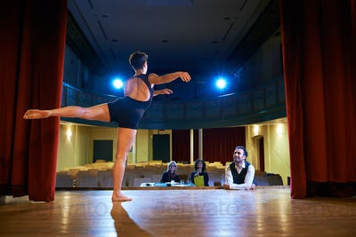 Woman Dancing For Audition With Jury In Theater