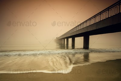 Bridge in а foggy morning