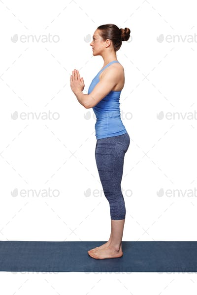 Woman doing Hatha Yoga asana Tadasana