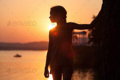 Portrait of sad little girl standing on the beach