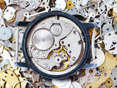 open used mechanical watch on heap of spare parts
