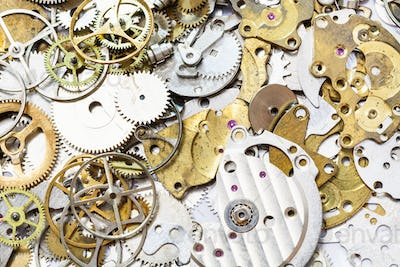 background from many old watch spare parts