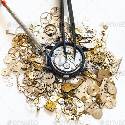 tools above watch on heap of spare parts