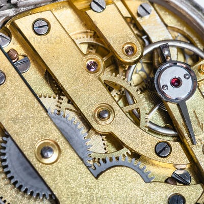 brass clockwork of old mechanical watch