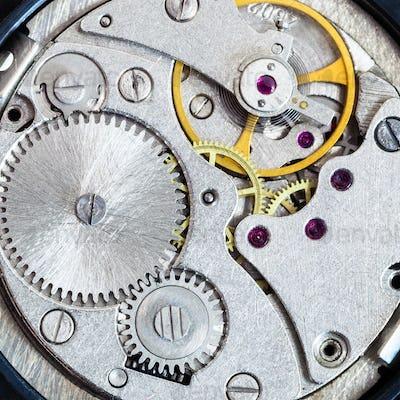 steel clockwork of old mechanical wristwatch