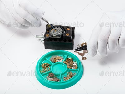 above view of repairing old mechanical watch