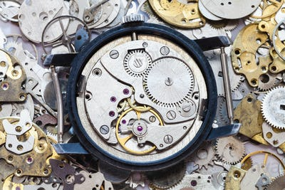 used mechanical wristwatch on heap of spare parts