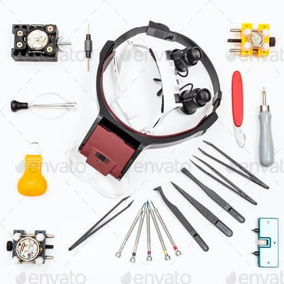 top view of various items for repairing watch