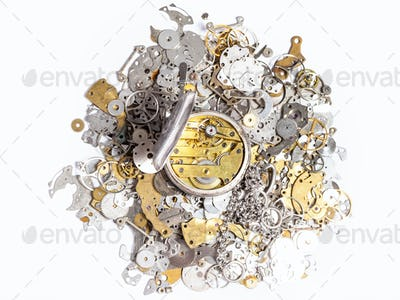 top view of pocket watch on pile of spare parts