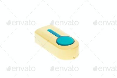 Yellow plastic doorbell.