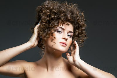 beautiful girl with curly hairdo