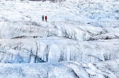 Detail view of two trekkers walking on the glacier, Vatnajokull