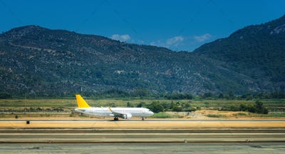 Beautiful white airplane on the runway in Dalaman airport