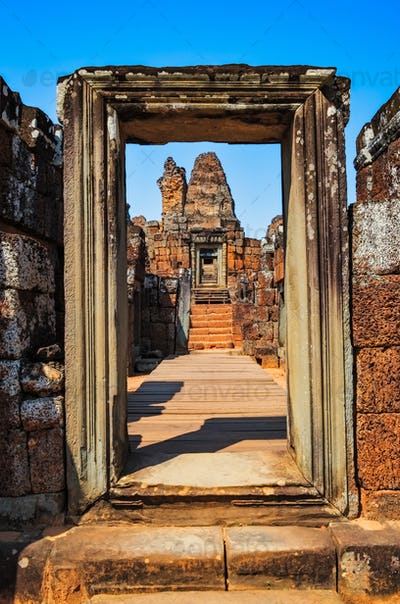 Detail of ancient stone temple entrance door at Angor Wat