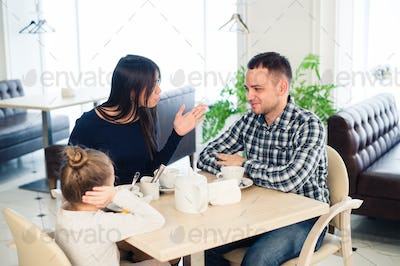 Little girl doesn't want to hear arguing of parents