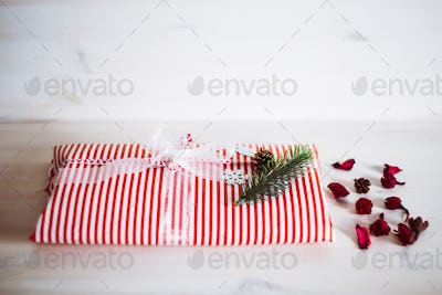 Christmas and New Year gift on white wooden background