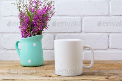 White coffee mug mockup with maroon purple flowers in mint pitch