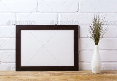 Black brown  landscape frame mockup with dark grass in elegant v