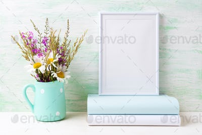 White frame mockup with chamomile and purple flowers in mint gre