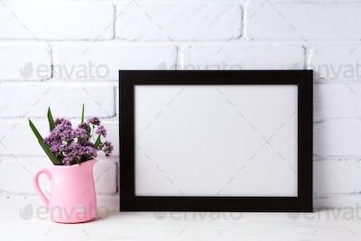 Black brown  landscape frame mockup with purple flowers in pink