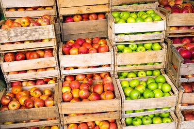 Fresh apples in wooden boxes for sale